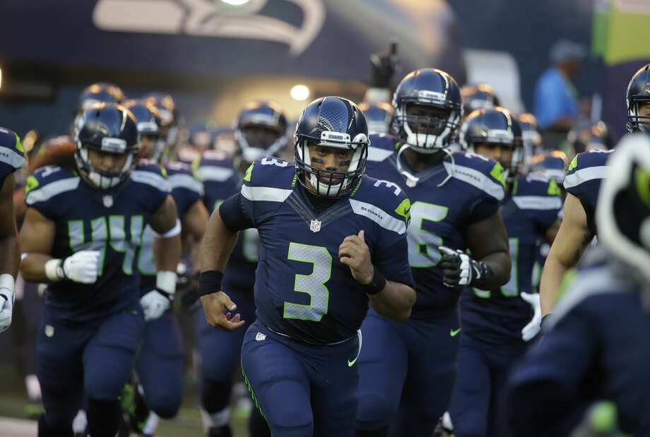 Seattle Seahawks quarterback Russell Wilson leads his team out of the tunnel for a preseason NFL football game against the Minnesota Vikings, Thursday, Aug. 18, 2016, in Seattle. (AP Photo/Elaine Thompson) Photo: Elaine Thompson/AP