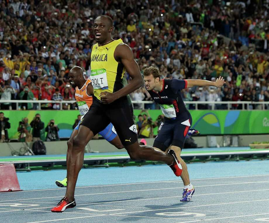 It was a laugher for Usain Bolt as he easily wins the 200 in 19.78 seconds to 20.12 for silver medalist Andre de Grasse. Photo: Matt Slocum, STF / Copyright 2016 The Associated Press. All rights reserved. This material may not be published, broadcast, rewritten or redistribu