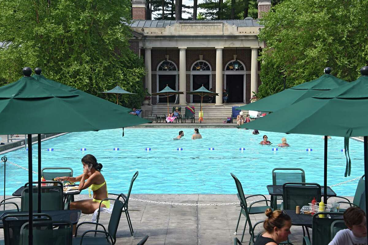 People enjoy the water at Victoria Pool on Wednesday, Aug. 17, 2016 in Saratoga Springs, N.Y. Louise Goldstein is trying to get repairs to the buildings surrounding the pool done with state money. (Lori Van Buren / Times Union)