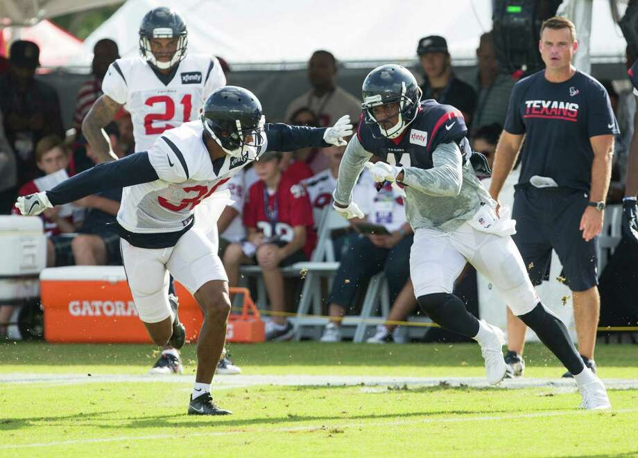 Texans cornerback Kevin Johnson, left, has made his presence felt - be it in camp against wide receiver Jaelen Strong or in the first preseason game against the 49ers - since recovering from offseason surgeries. Photo: Brett Coomer, Staff / © 2016 Houston Chronicle