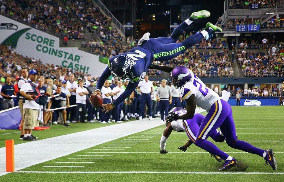 Seattle's Trevone Boykin (2) makes a dive into the endzone over Minnesota's Jayron Kearse to score a 2-point conversion in the fourth quarter of the Seahawks vs. Vikings pre-season game at CenturyLink Field, Thursday, Aug. 18, 2016. Photo: GENNA MARTIN, SEATTLEPI.COM / SEATTLEPI.COM