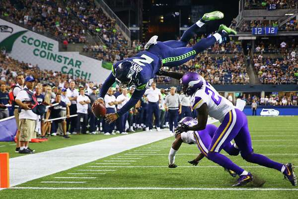 Seattle's Trevone Boykin (2) makes a dive into the endzone over Minnesota's Jayron Kearse to score a 2-point conversion in the fourth quarter of the Seahawks vs. Vikings pre-season game at CenturyLink Field, Thursday, Aug. 18, 2016.