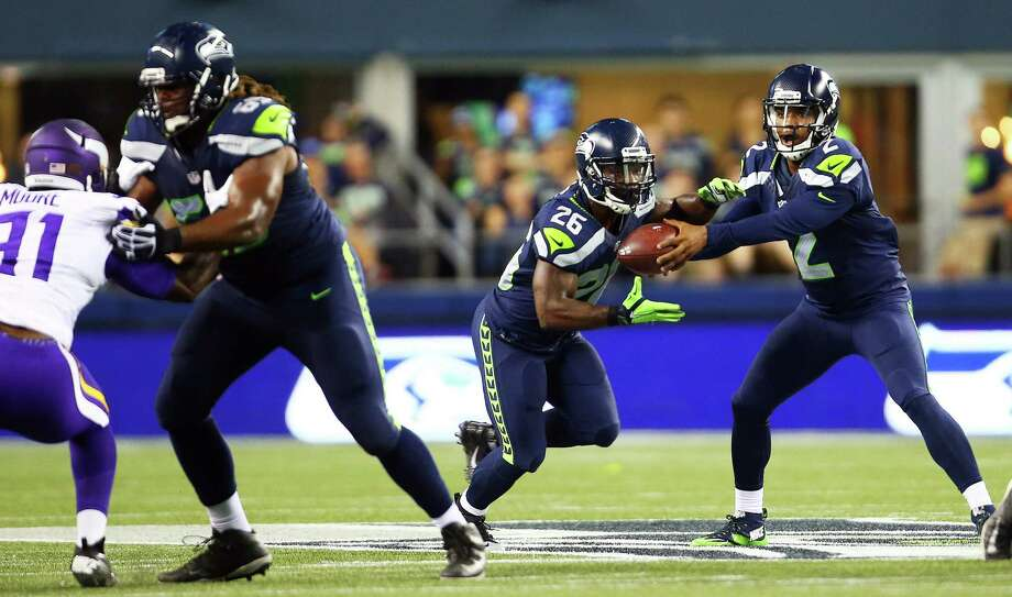 Seattle quartback Trevone Boykin (2) hands off the ball to running back Troymaine Pope (26) during the second half of the Seahawks vs. Vikings pre-season game at CenturyLink Field, Thursday, Aug. 18, 2016. Photo: GENNA MARTIN, SEATTLEPI.COM / SEATTLEPI.COM