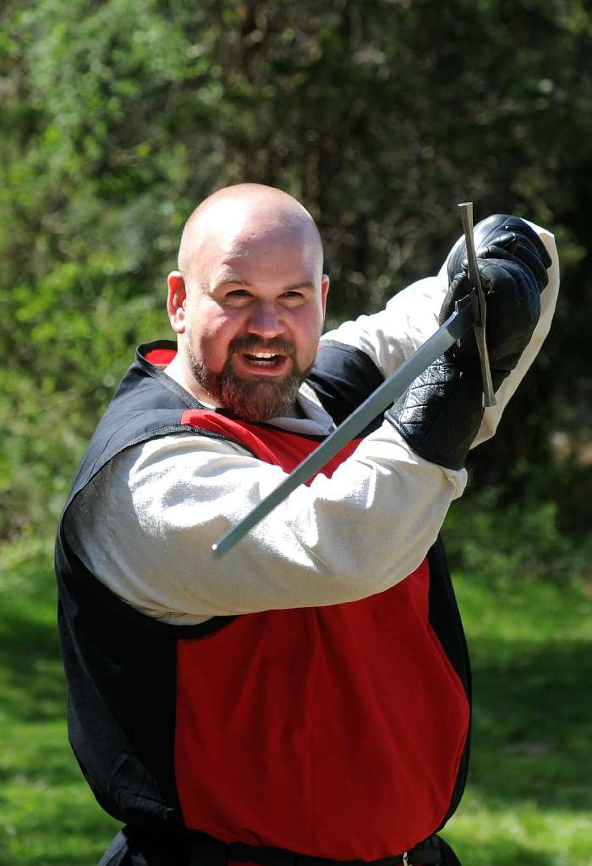 Rob Kelly, of Waterbury, an instructor with Selohaar Fechtschule in Oxford, leads a two-handed sword demonstration during the 12th annual Beltaine Festival at Schreiber's Farm in Oxford.