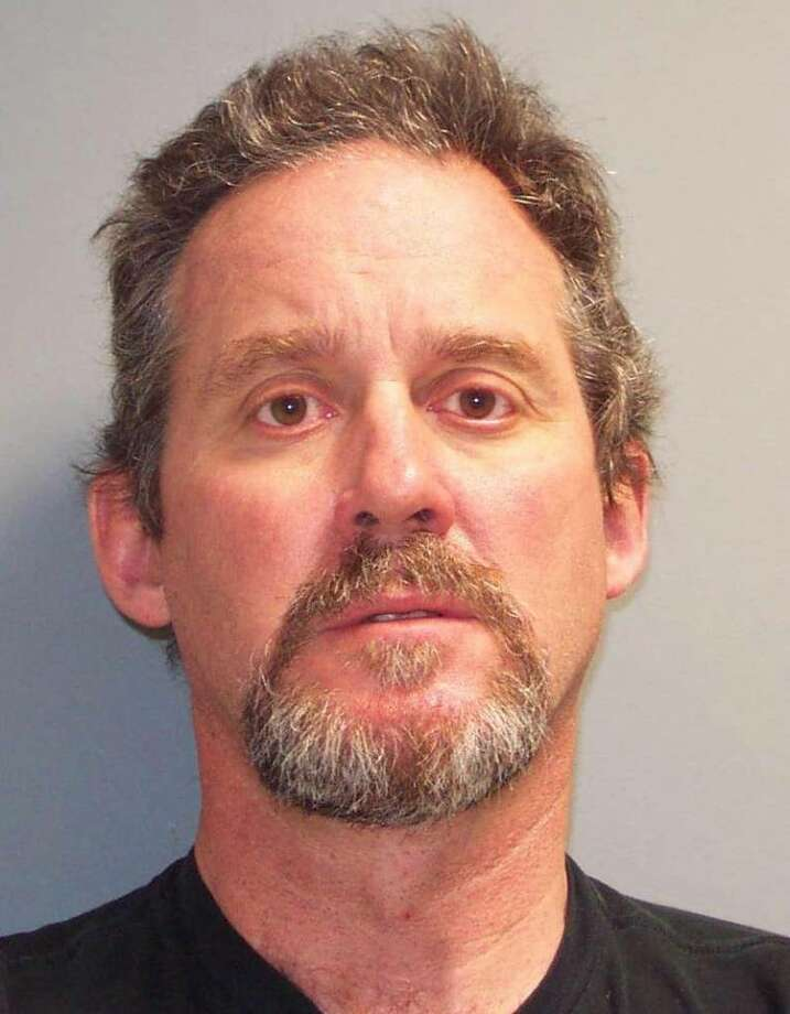 John Tate, 54, a teacher at Brien McMahon High School from Trumbull Conn. was arrested Thursday and charged with second-degree sexual assault for having an inappropriate sexual relationship with a 17-year-old student. Photo: Contributed Photo / Connecticut Post Contributed