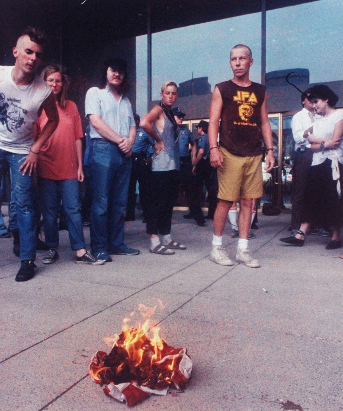Demonstrators burn an American flag to express anger against Reagan policies during the Republican National Convention. Outspoken radical Gregory Johnson was detained by police during the demonstration, august 1984. (Photo by Image Works/Image Works/The LIFE Images Collection/Getty Images)
