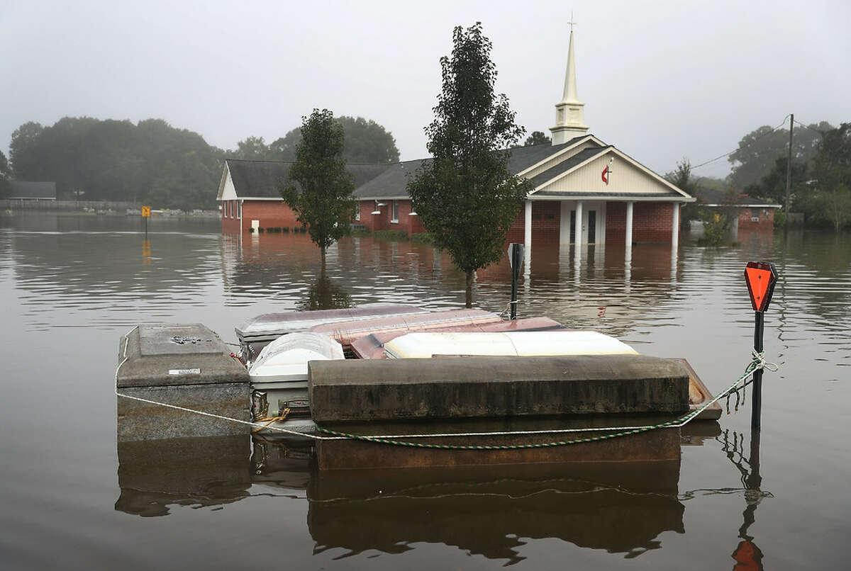 Death toll Louisiana floods: 13 Katrina: 1,833