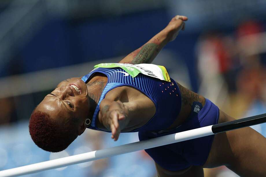 USA's Inika Mcpherson competes in the Women's High Jump Qualifying Round during the athletics event at the Rio 2016 Olympic Games at the Olympic Stadium in Rio de Janeiro on August 18, 2016.   / AFP PHOTO / Adrian DENNISADRIAN DENNIS/AFP/Getty Images Photo: ADRIAN DENNIS, Staff / AFP or licensors