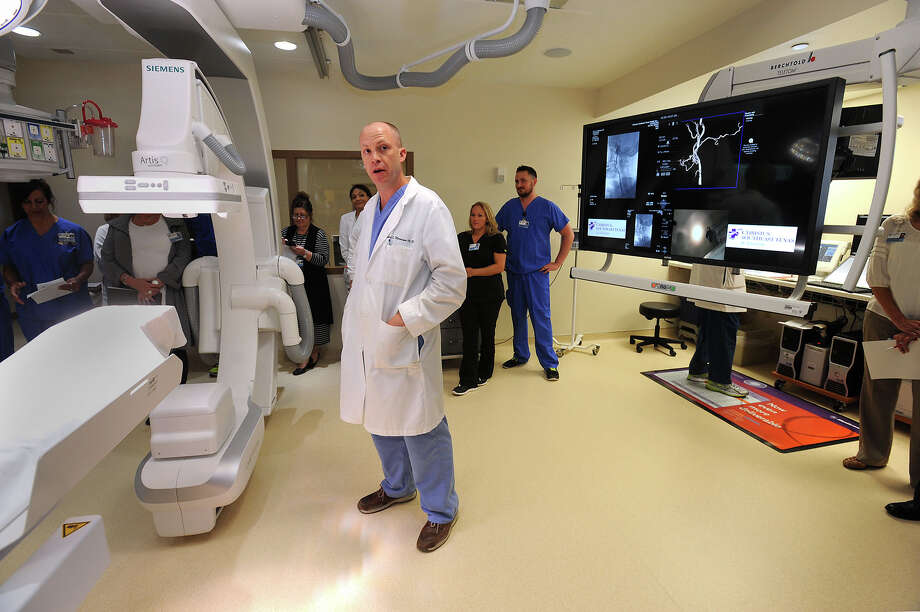 Robert Morrison an interventional radiologist addresses guests during the opening of St Elizabeth's new Cardiac Catheterization Lab on Thursday.  Photo taken Thursday, August 18, 2016 Guiseppe Barranco/The Enterprise Photo: Guiseppe Barranco, Photo Editor