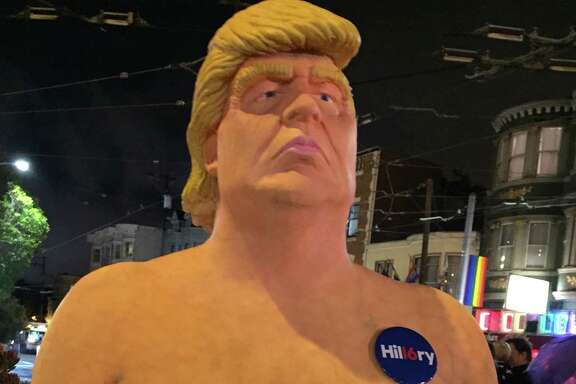 Naked Donald Trump statue in San Francisco's Castro District drew crowds late into Thursday night before it was removed by the city's Department of Public Works early Friday morning.
