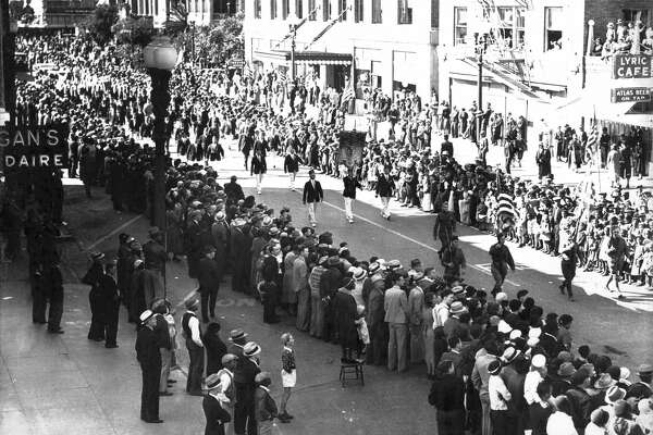 Main Street parade, circa 1930s. Presumably an Armistice Day parade. Location is between Dallas and Polk looking southward.