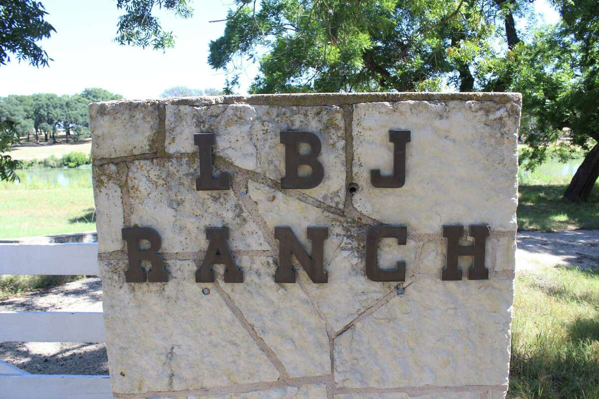 A sign greets visitors near the former entrance to the L.B.J. Ranch.