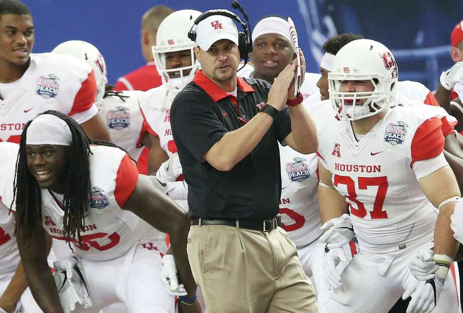 Houston Cougars coach Tom Herman watches play against Florida State during the first half of the Peach Bowl in Atlanta on Dec. 31, 2015. Photo: John Bazemore /Associated Press / Copyright 2016 The Associated Press. All rights reserved. This material may not be published, broadcast, rewritten or redistribu