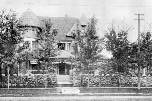 This was one of the plush mansions built in Midland about the turn of the century. Shown is the home originally owned by Dr. C.E. MacCallum and later by the Hon. W.D. Gordon, an attorney who served as Speaker of the House of Representatives and also as an attorney for the federal government. The carriage block at the curb was to allow ladies to step down from the high carriages without showing an ankle. The small building partially how at the right was a law and real estate office. During a fire about 1915, that started at the Brown Lumber Co. (then located next to the Gordon house at Ashman and Main streets) was destroyed. Some of the stones shown were used to build a mausoleum in Midland Cemetery where Mr. and Mrs. Gordon are buried