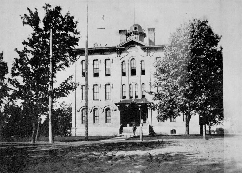 Midland's first high school located on Grove Street  at the end of McDonald. This was Union School and County Normal, housing 12 grades plus one, enabling students to earn a teaching certificate. George Fraser Hemingway, along with James S. Eastman, built the school in 1872 for $18,000, but actually lost money because of a sudden rise in labor costs that hit the county. Eastman declared bankruptcy, but all bills, including labor costs, were paid. Brick for the school was made at Eastman's farm. Wood came from the farm, too. At the time he took on the building job, Hemingway had a law office with Henry Hart, grandfather of Judge Hart. The school was destroyed by fire in 1908. Photo: Midland Daily News Archives