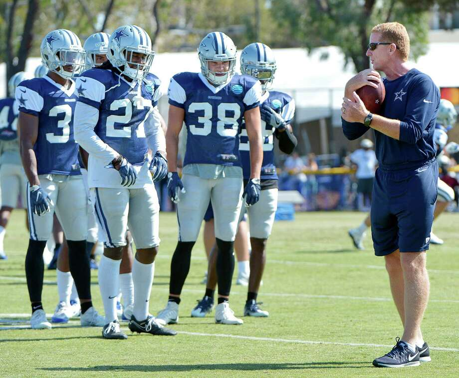 Before last season, Jason Garrett (right) signed a five-year contract to continue as head coach of the Cowboys. Photo: Max Faulkner /Fort Worth Star-Telegram / Fort Worth Star-Telegram