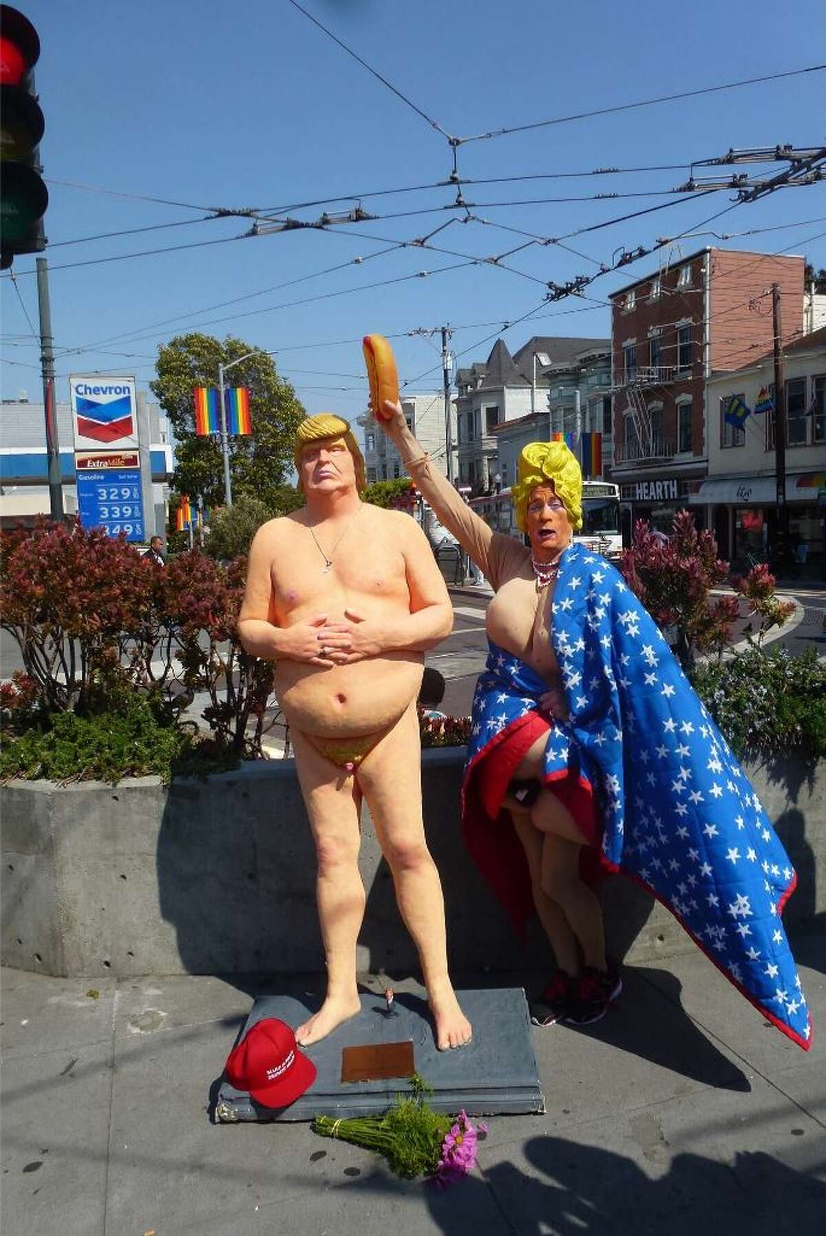 Mrs. Vera poses with the naked Donald Trump statue in San Francisco's Castro District.