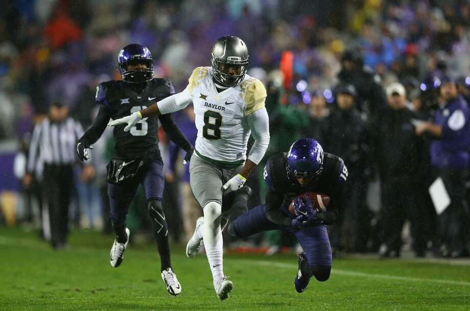 FORT WORTH, TX - NOVEMBER 27:  Nick Orr #18 of the TCU Horned Frogs makes a pass interception against Ishmael Zamora #8 of the Baylor Bears in the first quarter at Amon G. Carter Stadium on November 27, 2015 in Fort Worth, Texas.  (Photo by Ronald Martinez/Getty Images) Photo: Ronald Martinez/Getty Images