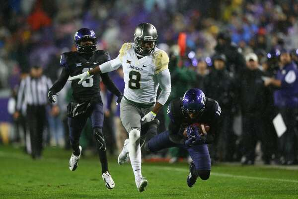 FORT WORTH, TX - NOVEMBER 27:  Nick Orr #18 of the TCU Horned Frogs makes a pass interception against Ishmael Zamora #8 of the Baylor Bears in the first quarter at Amon G. Carter Stadium on November 27, 2015 in Fort Worth, Texas.  (Photo by Ronald Martinez/Getty Images)