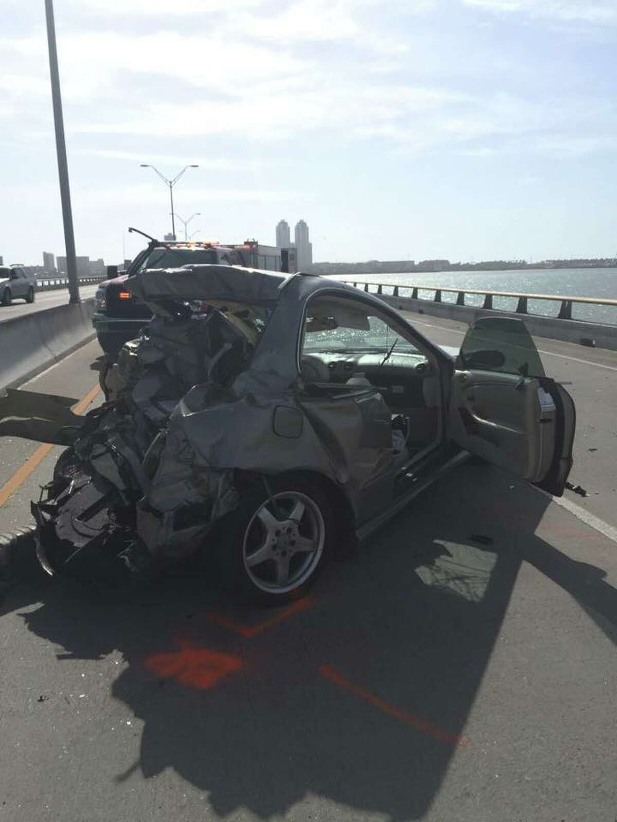 A woman died August 19, 2016 after the grey Mercedes-Benz she was traveling was rear-ended by a linen service truck on the Queen Isabella Memorial Causeway in South Padre Island.