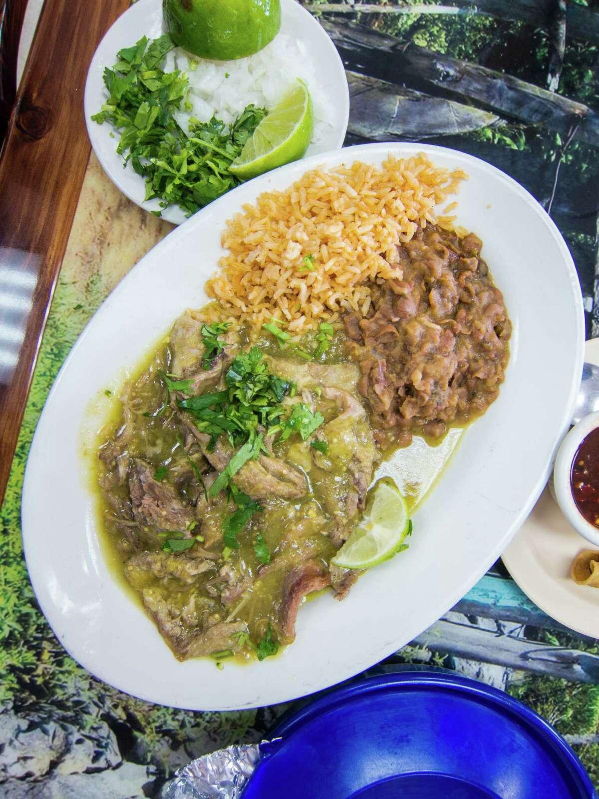 Barbacoa de Borrego in salsa verde features smoky, rich lamb.