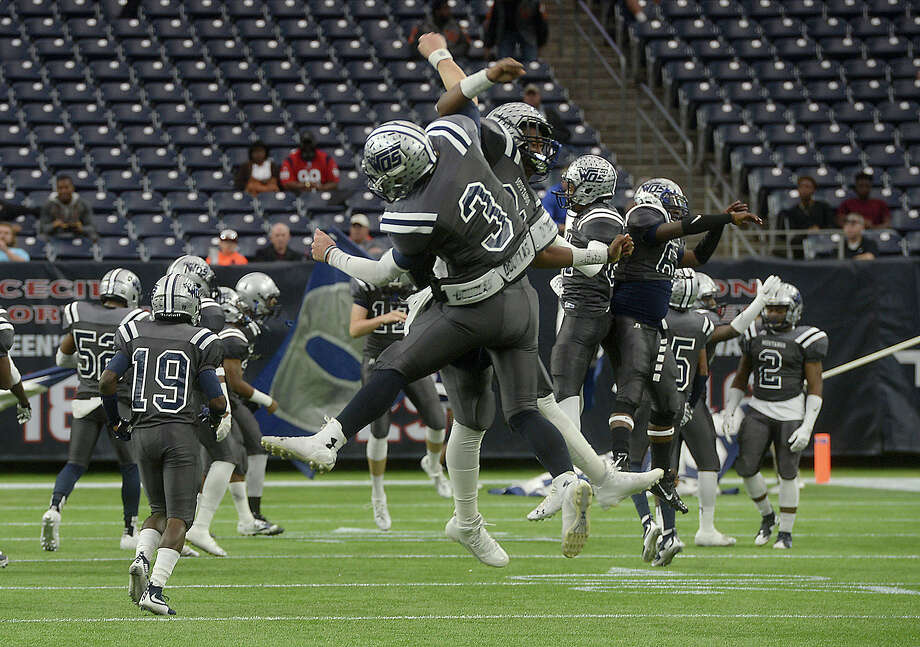 West Orange-Stark's Jack Dallas and Jeremiah Shaw get pumped up as they get ready to take the field against Celina during Friday's state finals championship game at NRG Stadium in Houston.   Photo taken Friday, December 18, 2015 Kim Brent/The Enterprise Photo: Kim Brent / Beaumont Enterprise