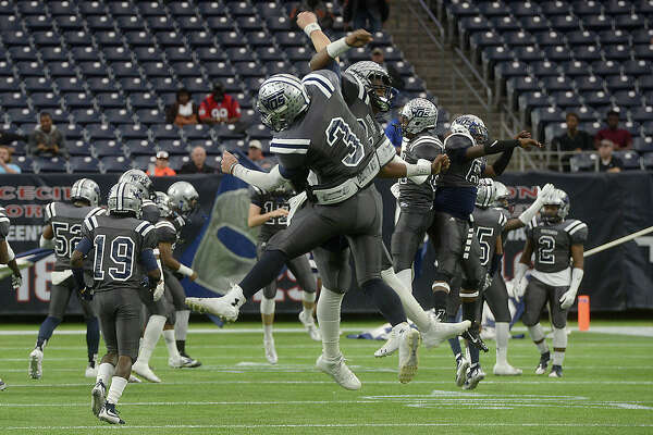 West Orange-Stark's Jack Dallas and Jeremiah Shaw get pumped up as they get ready to take the field against Celina during Friday's state finals championship game at NRG Stadium in Houston.   Photo taken Friday, December 18, 2015 Kim Brent/The Enterprise