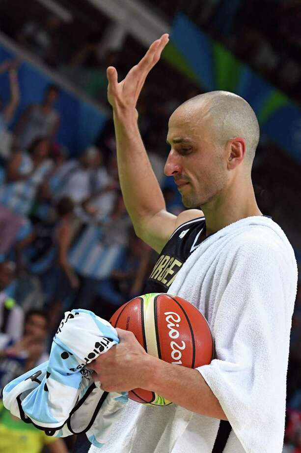 Argentina's shooting guard Manu Ginobili gestures as he leaves the court after losing to USA during a Men's quarterfinal basketball match between USA and Argentina at the Carioca Arena 1 in Rio de Janeiro on August 17, 2016 during the Rio 2016 Olympic Games. / AFP PHOTO / Mark RALSTONMARK RALSTON/AFP/Getty Images Photo: MARK RALSTON, AFP/Getty Images / AFP or licensors