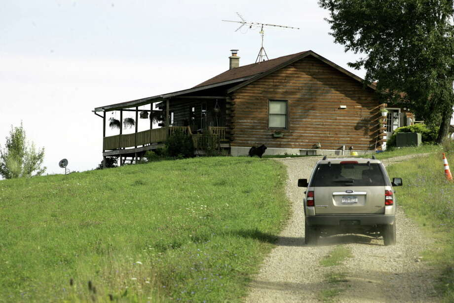 "A vehicle approaches the property near where two New York State Troopers were shot in Pomfret on Sept. 1, 2006. New York State Police have confirmed two troopers were in critical condition after being shot while staking out the hometown of an escaped convict's girlfriend in an ambush, and authorities were searching the area for the fugitive. Police believe the gunman was Ralph ""Bucky"" Phillips, who escaped from jail in April and may be traveling between Philadelphia and western New York, a State Police spokesman said. Photo: DAVID DUPREY, AP / AP"