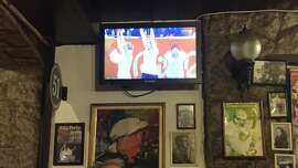 Watching handball in a Brazilian restaurant