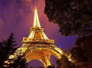 For an unforgettable evening in Paris, hire a cab or use a ride-sharing app to take a personal tour of floodlit monuments, such as the Eiffel Tower.