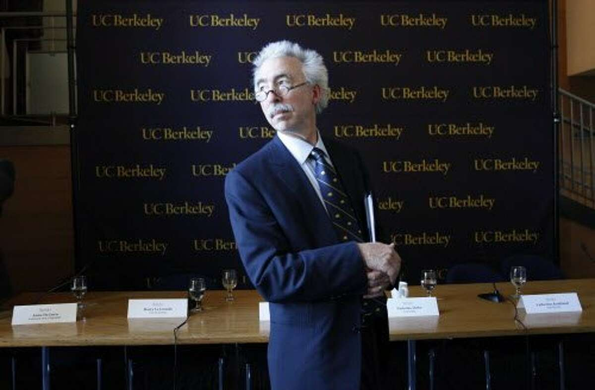 UC Berkeley chancellor Nicholas Dirks prepares to leave after the Chancellor's back-to-school news conference in Haas Pavilion at UC Berkeley on Monday, August 26, 2013 in Berkeley, Calif.