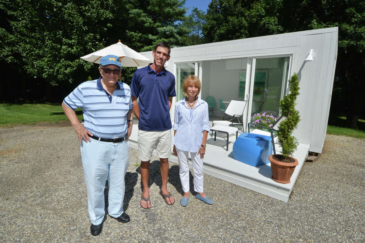 Elliott Kanbar, Sr. Business Manager, Matt Menozzi, Contractor and Barbara Rose, Designer stand in front of their model Elbar Pool House in Westport Conn. on Thursday August 18, 2016. Constructed from a shipping container and finished to the customer in about four weeks this model is the 160 sq ft. Pool House but there are bigger models up to the Elbar Estate at 960 sq ft with three bedrooms and two baths.
