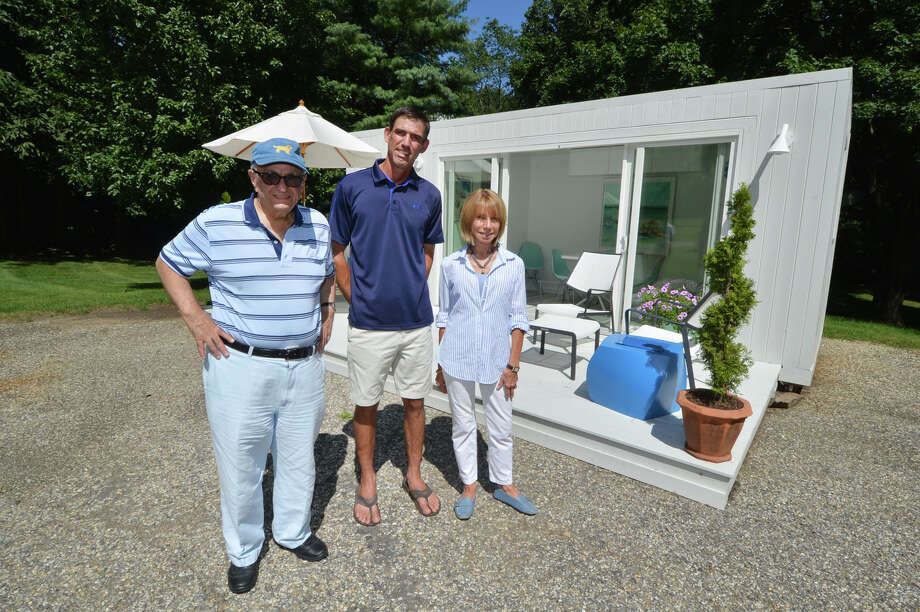 Elliott Kanbar, Sr. Business Manager, Matt Menozzi, Contractor and Barbara Rose, Designer stand in front of their model Elbar Pool House in Westport Conn. on Thursday August 18, 2016. Constructed from a shipping container and finished to the customer in about four weeks this model is the 160 sq ft. Pool House but there are bigger models up to the Elbar Estate at 960 sq ft with three bedrooms and two baths. Photo: Alex Von Kleydorff / Hearst Connecticut Media / Connecticut Post