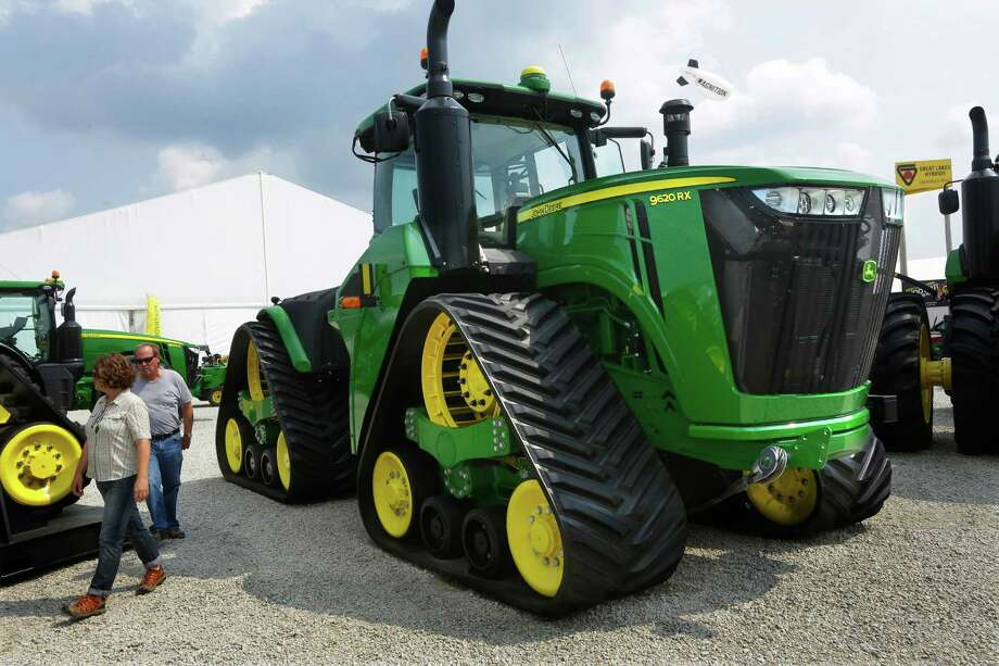 Deere & Co., the world's largest agricultural equipment maker, raised its full-year profit forecast after cutting production and costs to adapt to weaker demand for tractors and combines. Photo: Seth Perlman /Associated Press / Copyright 2016 The Associated Press. All rights reserved. This material may not be published, broadcast, rewritten or redistribu