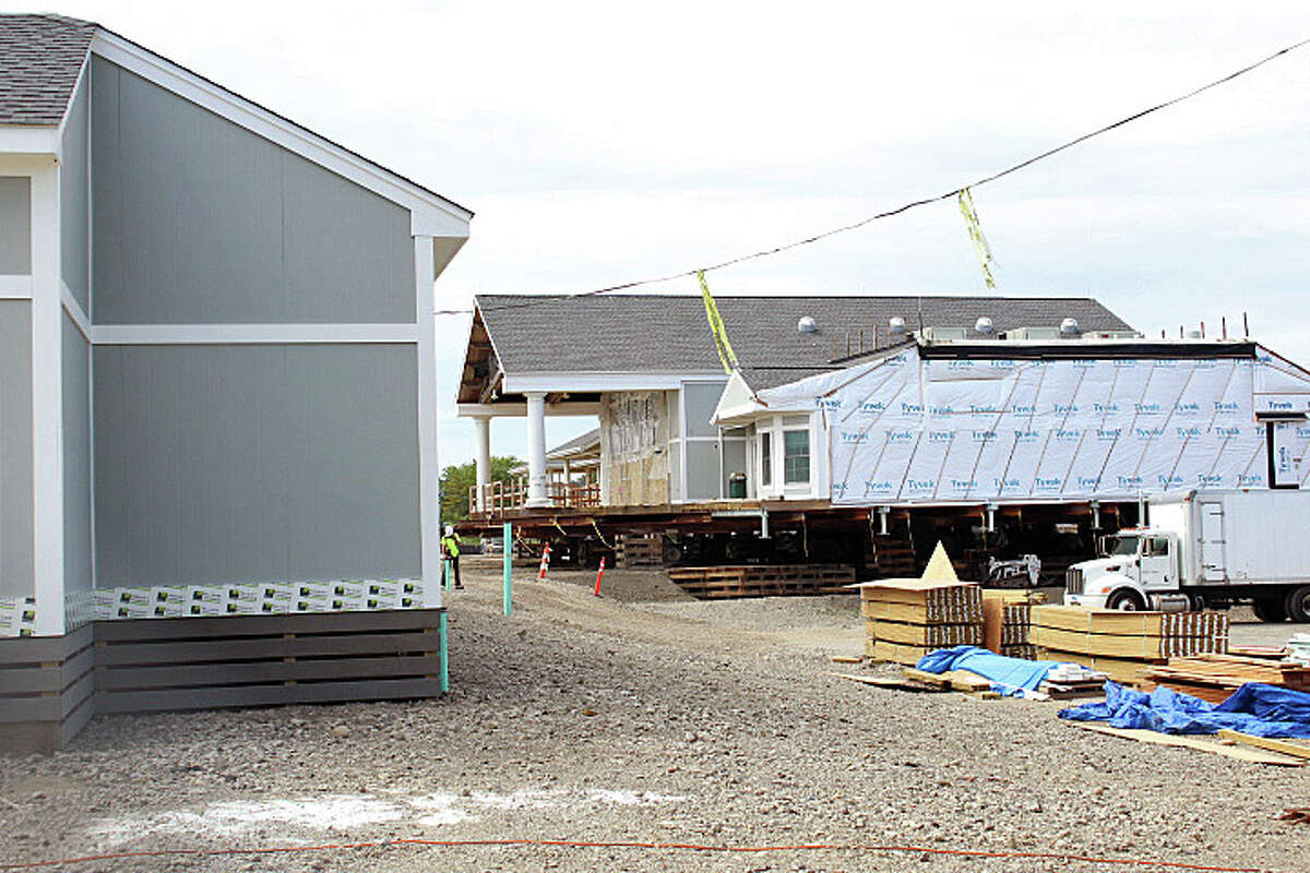 The reconstruction of Penfield Pavilion is running about three weeks ahead of schedule. The west wing, on the right, is expected to be moved out of the parking lot and onto a new foundation next week. Fairfield, CT. 8/18/16