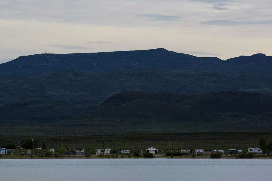 Trailer homes dot the landscape alongside Balmorhea Lake in Balmorhea   on Wednesday, August 17, 2016. The rise of fracking nearby the town  has some community members worried about their drinking water and  natural springs, which serve as a popular tourism destination helping  drive the town's economy. Photo: BRITTANY GREESON /San Antonio Express-News / © 2016 San Antonio Express-News