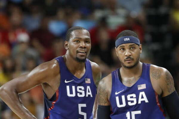 United States' Kevin Durant (5) stands with teammate Carmelo Anthony (15) as questions a foul call during a men's semifinal round basketball game against Spain at the 2016 Summer Olympics in Rio de Janeiro, Brazil, Friday, Aug. 19, 2016. (AP Photo/Eric Gay)