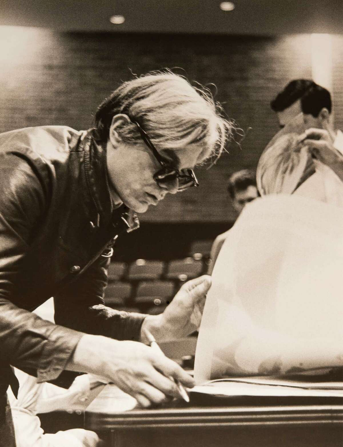 Andy Warhol signing posters, University of St. Thomas, Houston, 1968.