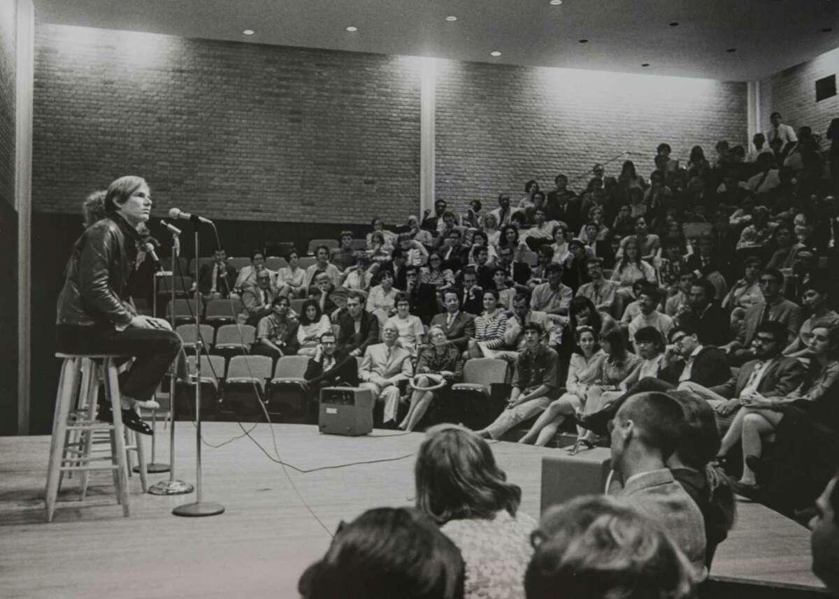 Andy Warhol with Viva, University of St. Thomas auditorium, Houston, 1968.