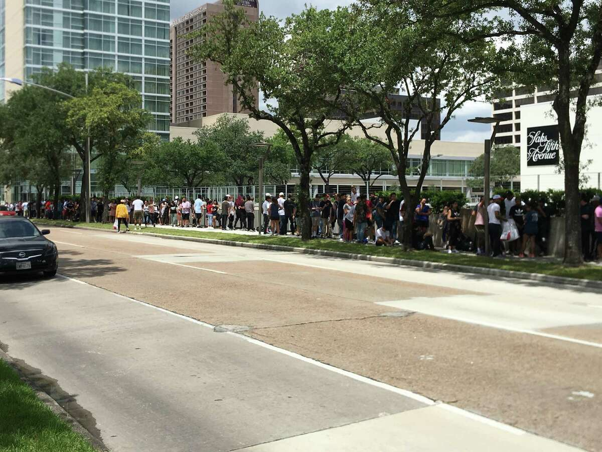 Fans wait in line for Kanye West PABLO shirts, jackets and hoodies outside The Galleria Friday morning. The pop-up shop will be there through Sunday.