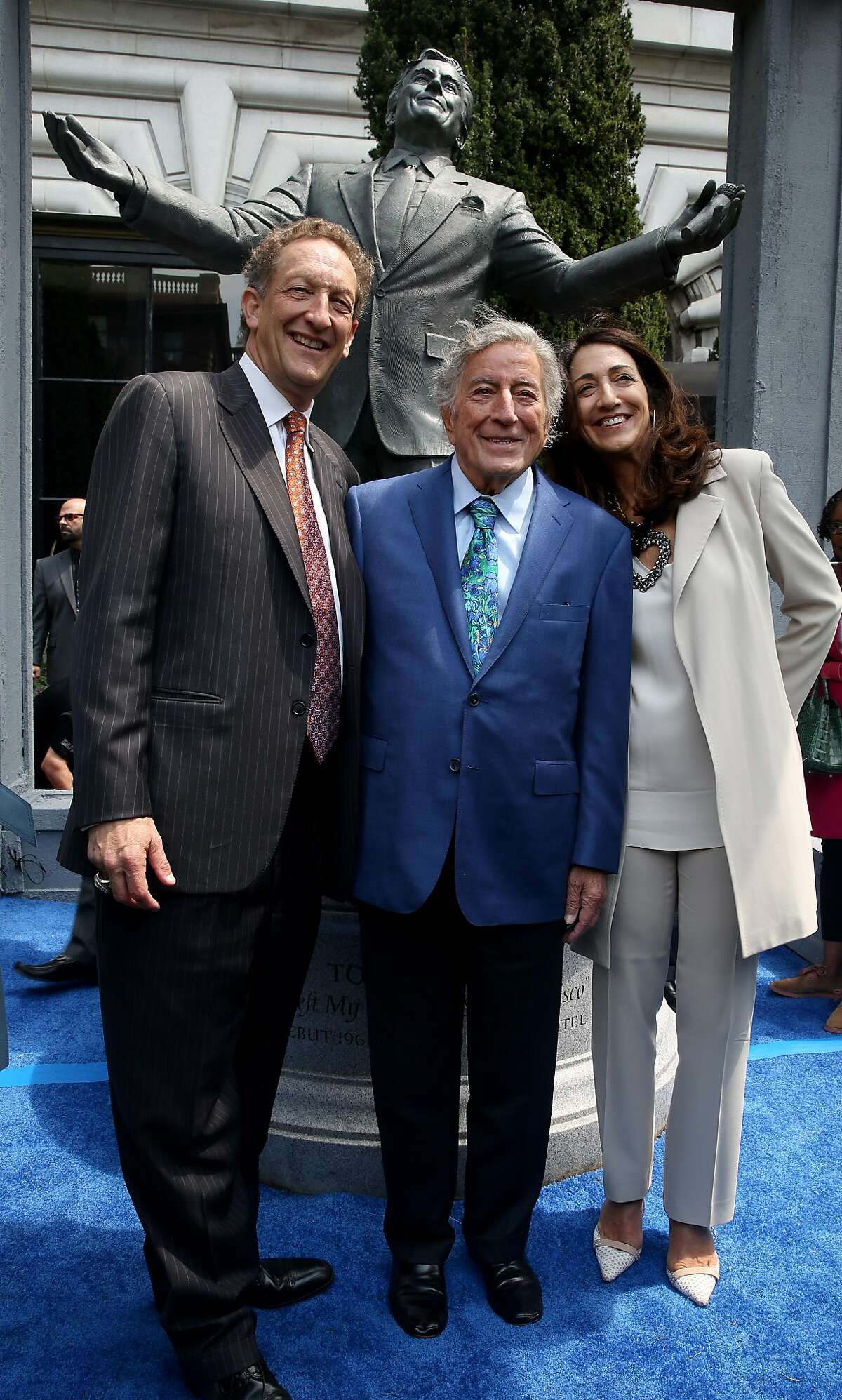 A bronze statue of Tony Bennett was unveiled on his birthday today as SF Giants' CEO Larry Baer (left) and his wife (night) join him in front of the Fairmount Hotel on Friday, August 19, 2016, in San Francisco, Calif.