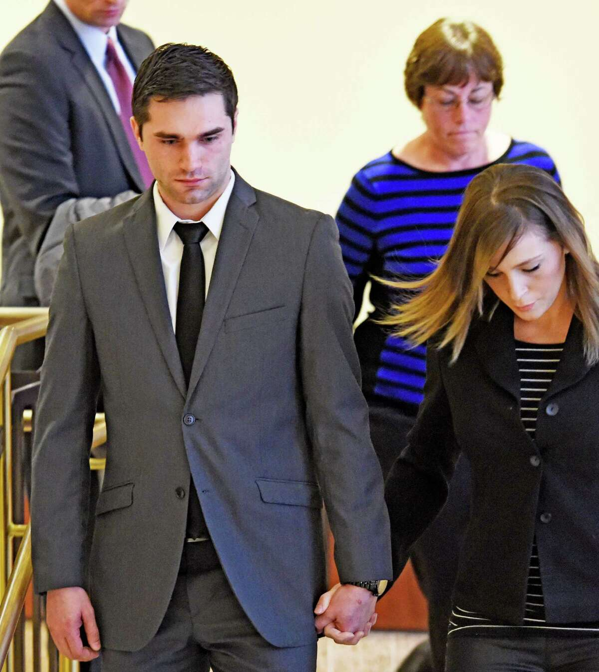 Tyler Pascuzzi of Coxsackie, left, leaves court after his appearance at the Albany Judicial Center on March 28, 2016, in Albany, N.Y. (Skip Dickstein/Times Union archive)