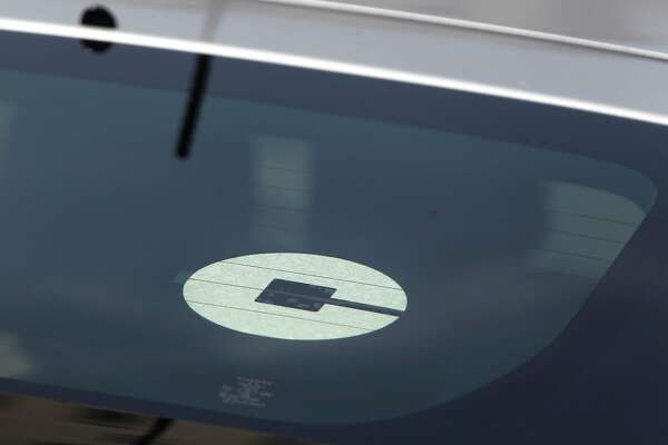 An Uber logo is seen on a vehicle on Friday, August 19,  2016 in San Francisco, California.