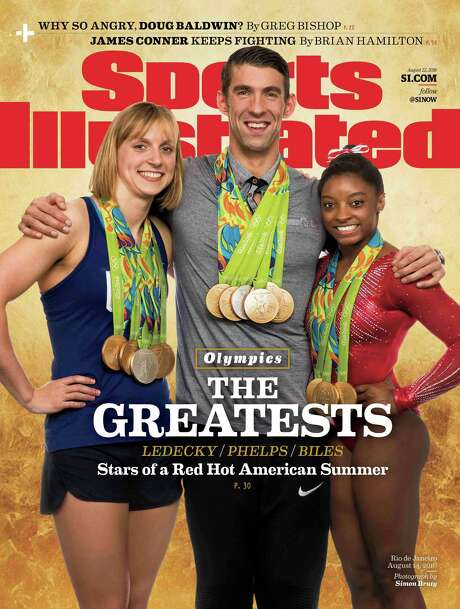 American gold medal winners Katie Ledecky, left, Michael Phelps, center, and Simone Biles on cover of Sports Illustrated Aug 16. That Phelps, an Under Armour athlete since 2010, would put a competitor's logo front-and-center on the cover of a national magazine that reaches more than 18 million people has insiders shaking their heads. Photo: Simon Bruty /Associated Press / Sports Illustrated