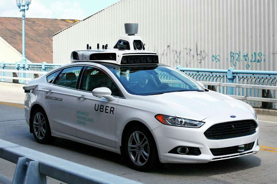 A self-driving Ford Fusion hybrid car is test driven, Thursday, Aug. 18, 2016, in Pittsburgh. Uber said that passengers in Pittsburgh will be able to summon rides in self-driving cars with the touch of a smartphone button in the next several weeks. The high-tech ride-hailing company said that an unspecified number of autonomous Ford Fusions with human backup drivers will pick up passengers just like normal Uber vehicles. Photo: Jared Wickerham /Associated Press / FR171279