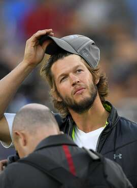 Los Angeles Dodgers pitcher Clayton Kershaw stands on the sideline during a preseason NFL football game between the Los Angeles Rams and the Dallas Cowboys, Saturday, Aug. 13, 2016, in Los Angeles. (AP Photo/Mark J. Terrill)