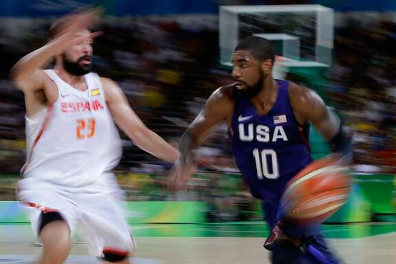 RIO DE JANEIRO, BRAZIL - AUGUST 19:  Kyrie Irving #10 of United States handles the ball against Sergio Llull #23 of Spain during the Men's Semifinal match on Day 14 of the Rio 2016 Olympic Games at Carioca Arena 1 on August 19, 2016 in Rio de Janeiro, Brazil.  (Photo by Jamie Squire/Getty Images)