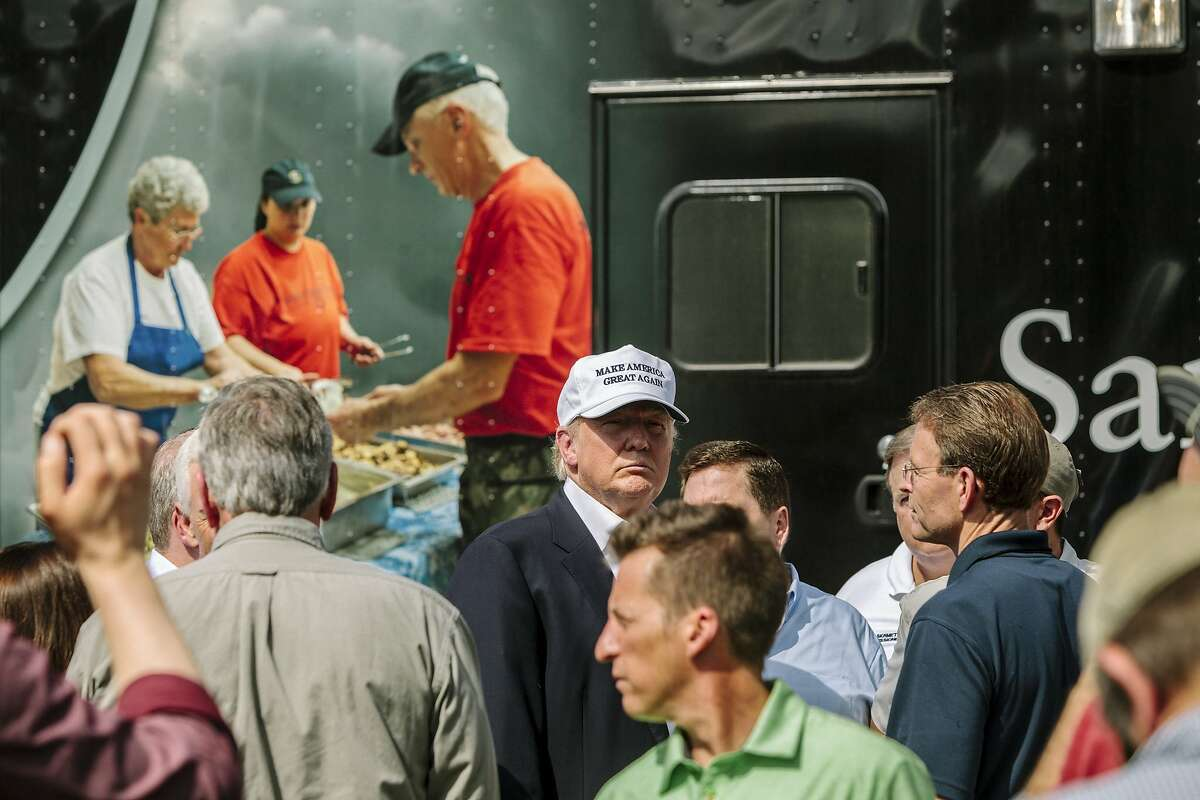Donald Trump, the Republican presidential nominee, while greeting supporters during a disaster relief event with Samaritan's Purse at Greenwell Springs Baptist Church in Central, La., Aug. 19, 2016. Southern Louisiana was ravaged by floods this past week. (William Widmer/The New York Times)