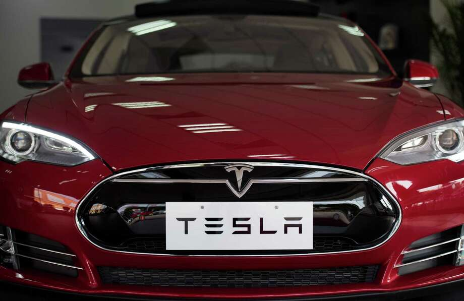 File photo of Tesla Model S in Shanghai. A Texas man whose Autopilot mode on his Tesla Model S sent him off the road and into a guardrail doesn't plan to sue the electric-car maker, but his insurance company might. Photo: JOHANNES EISELE /AFP /Getty Images / AFP or licensors